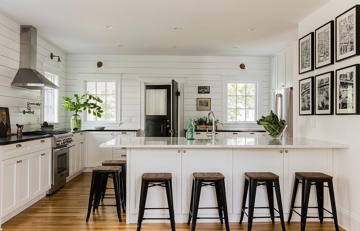 black-and-white-cottage-kitchen-peninsula-island-black-tolix-stools